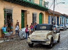 ... (Jean S..) Tags: trinidad cuba people street streetphotography car old ancient stone sky clouds blue red yellow cars