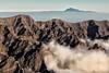 Two Islands And Seas (galvanol) Tags: atlanticocean canaryislands lapalma crater sky caldeiradetaburiente mood light island afternoon tenerife roquedelosmuchachos teide volcano volcanism clouds