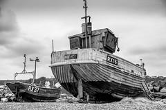Our Lady (ShrubMonkey (Julian Heritage)) Tags: rx16 fishingboat boat clinker wooden hull old shingle beach coast coastal nautical mono bw thestade hastings eastsussex ourlady ropes nets sea bow sky