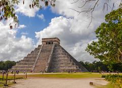 El Castillo framed (Adaptabilly) Tags: grass shadow people mx chichenitza clouds religion ruins travel mayan mexico archaeology yucatán pyramid tree sky stairs lumixgx7 kukulkan