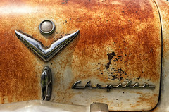 old warrior (Maureen Bond) Tags: ca maureenbond car automobile classic vintage chrysler rusty chrome emblem trunk iphone 52in2018 filltheframe
