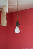Light Bulb against Red Wall in Abandoned Home in Ohio (Russ Kerlin Photography) Tags: abandoned home ohio lightbub light red