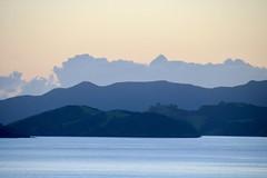 Sunrise, Bay of Islands, New Zealand (adamsgc1) Tags: newzealand bayofislands sunrise mountains water queenelizabeth cunard