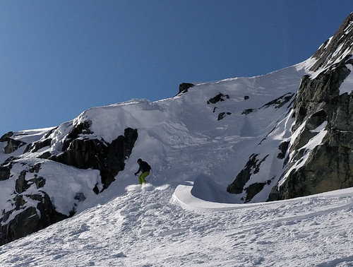 Skiing out from the cornice drop