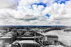 """""""The only thing that makes life possible is permanent, intolerable uncertainty: not knowing what comes next."""" ―Ursula K. Le Guin ☁️ 💦 (anokarina) Tags: psmobile adobephotoshopexpress colorsplash appleiphonese 💦 ☁️ window ohioriver clouds blue city urban skyline"""