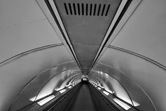 Nostromo (Douguerreotype) Tags: monochrome underground ceiling lights city bw station uk metro british england mono blackandwhite tunnel britain urban subway london gb roof tube