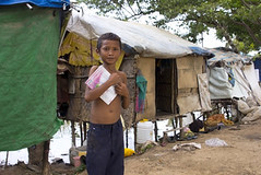 Boy in slum holding book want to go school (cfdtfep) Tags: asian child childhood boy young girl kid baby infant ghetto play playful orphanage housing slum shanty health problem unhealthy indigence food hunger hungry toy ngo education student school class classroom book notebook junk yard gather rubbish trash waste dump pollution poverty poor dwelling dirt dirty cambodia asia garbage dumping area phnompenh