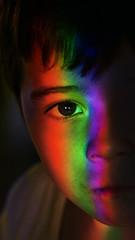 038 of 365 - Colorful (Weils Piuk) Tags: photoblog365 rainbow kid color spectre sad boy infrared ultraviolet inbetween look portrait dark side moon ringing trough his skull