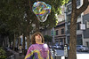 The Bubble Blower (Generik11) Tags: people parade ststupidsdayparade ststupidsday2018 aprilfoolsday costumes art politics signs religion 40thannual sanfranciscomimetroupe sf reflections