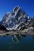 Cholatse (6440m) reflected (JinxiPhotography) Tags: nepal everest trek cholatse reflect reflection clear cloud day himalaya peak glacier khumbu pass lake pond mountain asia still water blue rock stone snow sky