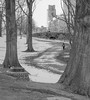 winding path (richardroyle) Tags: path garden snow winter bag person boston city urban pretty unique interesting experimental landscape winding curve wind bind trees texture grass plants different artsy artistic hipster special stone reeds pond bridge blackwhite bw monochrome jacket building architecture cityscape background foreground contrast composition