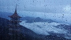 The nicest thing about the rain is that it always stops. ... (blink4blink) Tags: window rain pane pagoda clouds mountain dewdrop blue