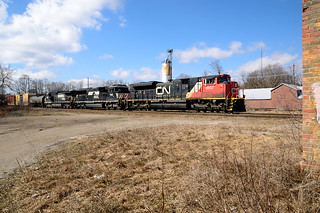 CN 394 makes it way past the old Ingersoll station with a couple NS horses in tow
