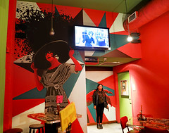New Orleans (kirstiecat) Tags: 13 frenchmenstreet restaurant neworleans nola louisiana stranger woman beautifulstranger art mural graphic comic whoseafraidofvirginiawoolf cinematic film movie female red colors saturation street canon imagination creative artistic cafe