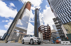 Hudson Yards Ant's Eye View (20180408-DSC04012) (Michael.Lee.Pics.NYC) Tags: newyork hudsonyards construction vessel reflection car 11thavenue architecture cityscape clouds sony a7rm2 voigtlanderheliar15mmf45