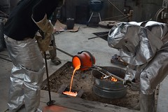 Bronze casting 4 (orientalizing) Tags: artstudio bronze casting crucible forge nebraska spacesuit unl usa