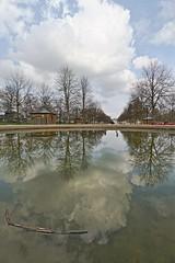 Promenades réflectives (Tonton Gilles) Tags: hdr alençon normandie parc des promenades allée centrale jets deau bassin reflets nuages ciel paysage urbain