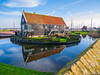 Traditional house surrounded with water (✦ Erdinc Ulas Photography ✦) Tags: panasonic house building dutch holland nederland netherlands roof water reflection culture enkhuizen city old grass sky clouds boat wood architecture fence travel focus detail landscape wall moss