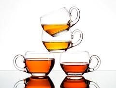 Tea (Karen_Chappell) Tags: teacup tea teacups beverage liquid white cups cup glass stack balance stilllife orange reflection four 4