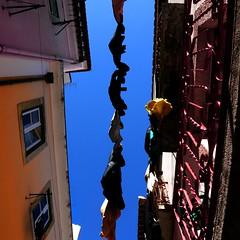 the sky over lisbon (alfama - lisboa, portugal) (bloodybee) Tags: hanginglaundry laundry street lisbon lisboa portugal europe house building facade alfama washing sky balcony window alley square