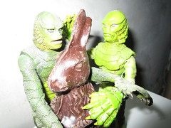 Easter Creature and Chocolate Rabbit 9075 (Brechtbug) Tags: easter creature chocolate bunny rabbit 2018 universal pictures studio black lagoon monsters new york city undead zombie cadaver horror terror halloween fright toy toys moody shadow shadows face portrait 1954 movie film hollywood fish man gill gillman collectable collectible type lite light holiday gloomy goth gothic action figure chocolates eeeaster april fools green 04012018