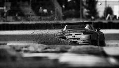 Bennett exploring the limits (speedcenter2001) Tags: 54 porsche911gt3r gtd jonathanbennett colinbraun roadamerica roadcourse roadracing race racecar racetrack racing motorsports competition rennsport imsa sportscar elkhartlake elkhart wisconsin 400mmf28gvr nikon400mmf28gvr silverefexpro2 monochrome blackandwhite noiretblanc schwarz weiss german debris dirt offroad
