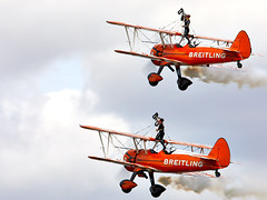 Wing walkers (Bernie Condon) Tags: uk british shuttleworth collection oldwarden airfield airshow display aviation aircraft plane flying breitling wingwalkers girls ladies aerobatics wingwalking aerosuperbatics boeing stearman trainer vintage classic preserved biplane