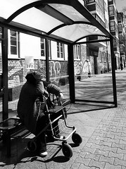 Waiting for the happiness bus (TheBrokenLevee) Tags: berlin berlino woman streetphotography street bus busstop city urban sadness sad blackandwhite bnw urbanandstreet bandw