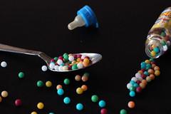 Sugar balls (priolo_vittoria) Tags: cake sweet dessert color beautiful food light sugar sugarballs background spoon bottle pacifier black composition stilllife dolce tasty cibo composizione cucchiaio biberon nero