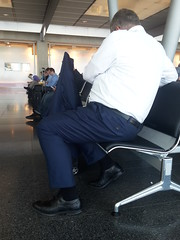 Airport Daddy - Black Wingtips 04 (TBTAOTW2011) Tags: airport hidden camera candid daddy dad mature old grey gray salt pepper belly beefy chubby glasses sitting socks black leather dress shoe shoes wingtip wingtips crossed legs businessman business man suit