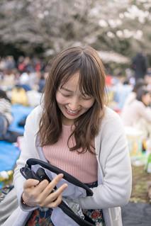 Young woman folding reflector