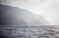 Ghostly Coast (Jonathan Miske) Tags: canon canon6d canonef70200mmf4lisusm canoneos6d hawaii kauai napalicoast sunsetcruise usa unitedstates waimea haze pacificocean pacific ocean na pali coast grey cloudy mist