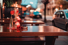 let's drink some beer (thethomsn) Tags: drink beer flower table bokeh street restaurant bar faded candle vase tulip
