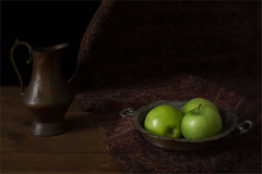 Still Life with Green Apples (suzanne~) Tags: stilllife apple fruit pitcher ikat tabletop dark lensbaby softfocusoptic