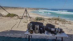 The office ( Greenly Beach ) (Malcom Lang) Tags: office hardwork sweatingit out cliff autumn sunlight sunshine day daylight beach sand sandhills rocks shrubs coast coastline tide water ocean oceanlife southernocean waves surf seagull alone grass horizon view scenery scene rope ropes tyedown tripod camera cameragear lenses lens filter filters bags table legs southaustralia southern south southernaustralia southerneyrepeninsula eyrepeninsula eyre lowereyrepenninsula australia australian aussie outside outdoor outdoors shadow mal lang photography beer stubbieholder bostontigers