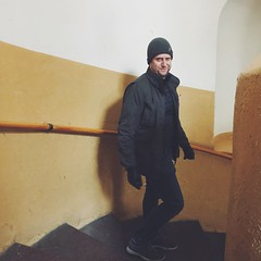 caught you (mennyj) Tags: vacation 2018 march international travel wanderlust europe mobile iphone iphone7 airbnb prague czech republic czechia karlin markham stairs staircase yellow white cold winter outside brrr
