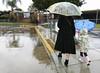 Kindergarten Orientation (evaxebra) Tags: umbrella umbrellas kindergarten orientation holding hands walking rainboots boots coat rain raining