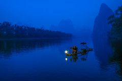 Fisherman and Cormorant (3dgor 加農炮) Tags: guilin lijiang fisherman river blue