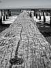 Old cracking historic boat bridge. (J.J.M. Productions) Tags: blackwhitephotos timaru otipua new zealand closeup crackling beach old bridge boat water sea pacific island productions south