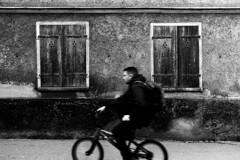 One-hand driver (Leica M6) (stefankamert) Tags: stefankamert street tones textures house driver bicycle man people noir blackwhite blackandwhite film analog grain kodak trix leica m6 leicam6 summicron summicrondr motionblur lines tübingen window
