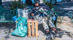 2018 - Mexico City - Roma Norte - Homeless (Ted's photos - For Me & You) Tags: 2018 cdmx cityofmexico cropped mexico mexicocity nikon nikond750 nikonfx tedmcgrath tedsphotos tedsphotosmexico vignetting bench homeless homelessperson male poor needy shadow shadows streetscene street ballcap bags crate legs sneakers broom blankets man nike