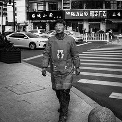 Dress code (Go-tea 郭天) Tags: hangzhoushi zhejiangsheng chine cn linan hangzhou portrait man old walk walking alone lonly uniform cap strange movement sidewalk pavement zebra crossing cars road street urban city outside outdoor people candid bw bnw black white blackwhite blackandwhite monochrome naturallight natural light asia asian china chinese canon eos 100d 24mm prime