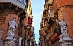 Malta Streets (Douguerreotype) Tags: statue city street window balcony buildings malta architecture valletta urban