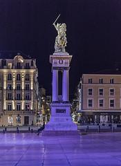 Waiting patiently (David Feuerhelm) Tags: night nikkor light lighting man statue colour purple building buildings city square jaude clermontferrand auvergne france nikon d750 2470mmf28