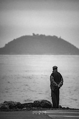 Contemplating the Island (Ragnarøkkr) Tags: ifttt 500px nikon d7200 tamron18400 horizon over water sea waterfront seascape wave island man black white