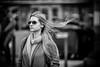 (graveur8x) Tags: woman candid street portrait frankfurt germany deutschland streetphotography glasses sunglasses blond hair wind scarf dof girl female human blackandwhite monochrome schwarzweis bw people outside outdoor cool spring lights strase city stadt canon canoneos5dmarkiv 135mm canonef135mmf2lusm f2 l