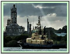 Tug and refinery 2 (agphoto100) Tags: boat tug water river brisbane fuji fujifilm sun cloud ray work metal shine f770exr