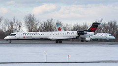 Old and New (Ben_Senior) Tags: ottawa ontario canada ottawamcdonaldcartierairport ottawainternationalairport ottawaairport cyow yow airport runway takeoff final approach landing bensenior planespotting nikond7100 nikon d7100 bombardier crj crj900 embraer ejet e190 cfjzl cfnan livery oldlivery newlivery ac aca qk jza aircanada aircanadaexpress jazzair aircanadajazz regionaljet regionalairline narrowbody rj cf34
