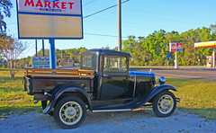Ford Model T, Florida Ave. South of Hernando, FL(1 of 3) (gg1electrice60) Tags: ford pickuptruck nexttocatnapinn nexttokoalateeacademy 5600sfloridaave 5600southfloridaavenue acrossfromshellgasstation acrossfromcirclekconveniencestore neargoodcounselcamp intersectionofwgobblerctsfloridaave intersectionofegobblerrdsfloridaave eastgobblerroad westgobblercourt countyroad39a cr39a citruscounty floralcity florida fl unitedstates usa us america vehicle truck farmersmarket vendors signs produce seafood blackpickup grass trees gasstation shell usflag catboarding 1930modela