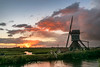 Windmill Sunset (mesocyclone70) Tags: sunset mill windmill water reflections sky clouds cloudscape holland color field cloud netherlands dutch grass polder skyscape